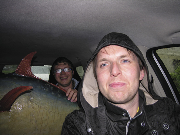 Møllerhaug created numerous projects with fellow artist Espen Sommer Eide. Here they're on their way to a performance of Archive Circus (Rural Readers) Møllerhaug takes care of a 100 years old moon fish in the back seat.